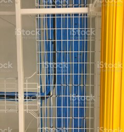 lan cable wiring on the cable rack in the datacenter stock image  [ 768 x 1024 Pixel ]