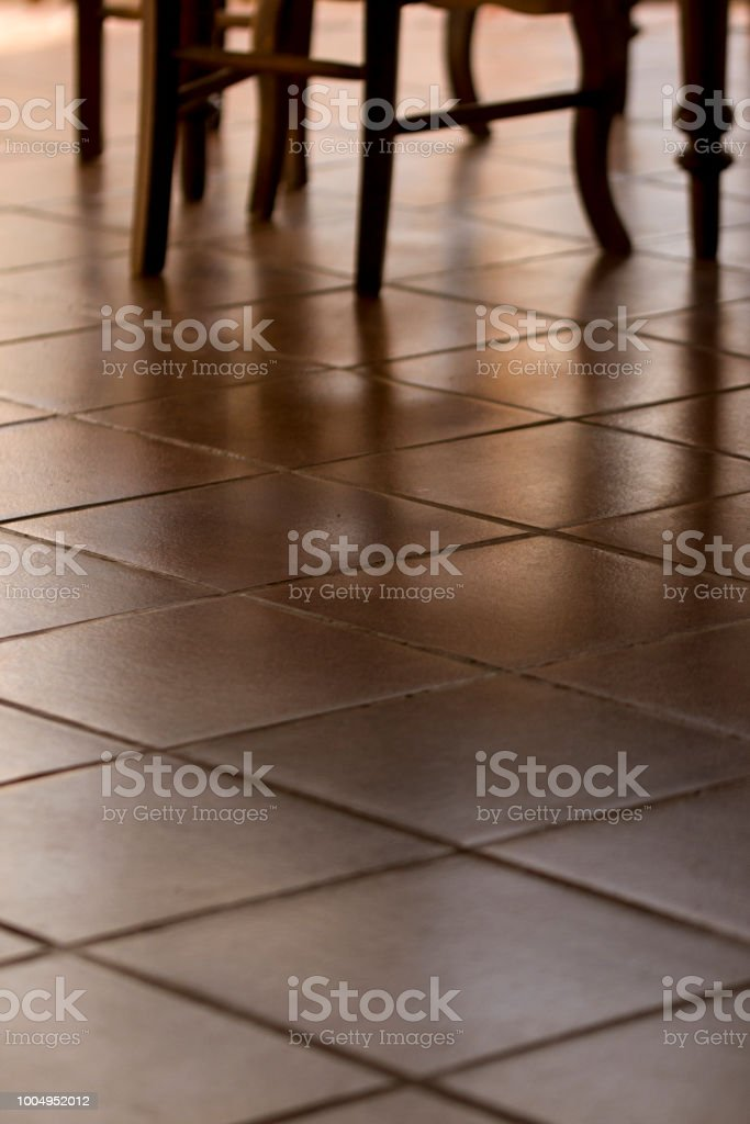https www istockphoto com photo chair legs and terracota floor tiles normandy style french gm1004952012 271377740