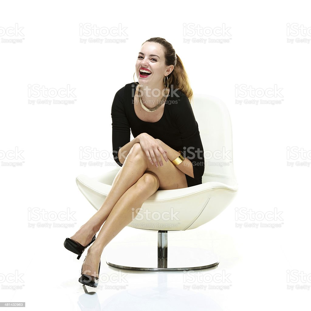 woman sitting in chair best dining chairs modern cheerful on looking at camera stock