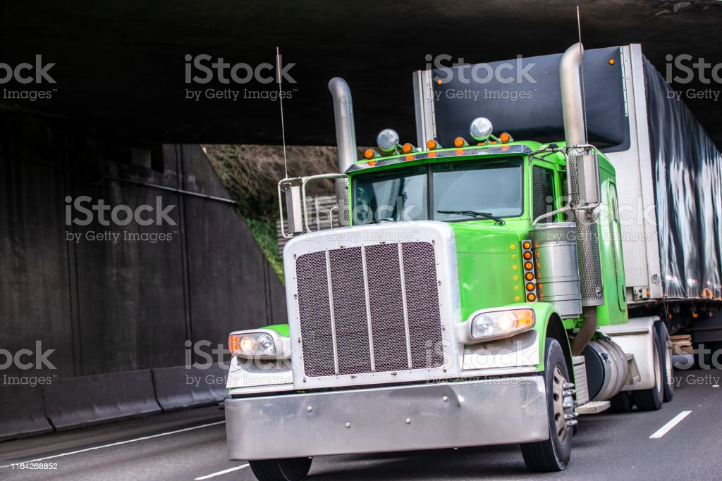 classic big rig green bonnet semi truck with vertical exhaust pipes stock images page everypixel