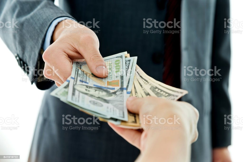 Handing Out Money Stock Photos. Pictures & Royalty-Free Images - iStock