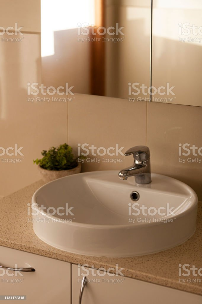 https www istockphoto com photo contemporary bathroom faucet vanity in diffused residential afternoon light gm1181172315 331175798