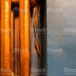 Copper Heating Radiator With Blue Wall Background Stock Photo Download Image Now Istock