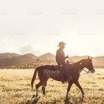 Cowboy Horseback Riding Stock Photo Download Image Now Istock