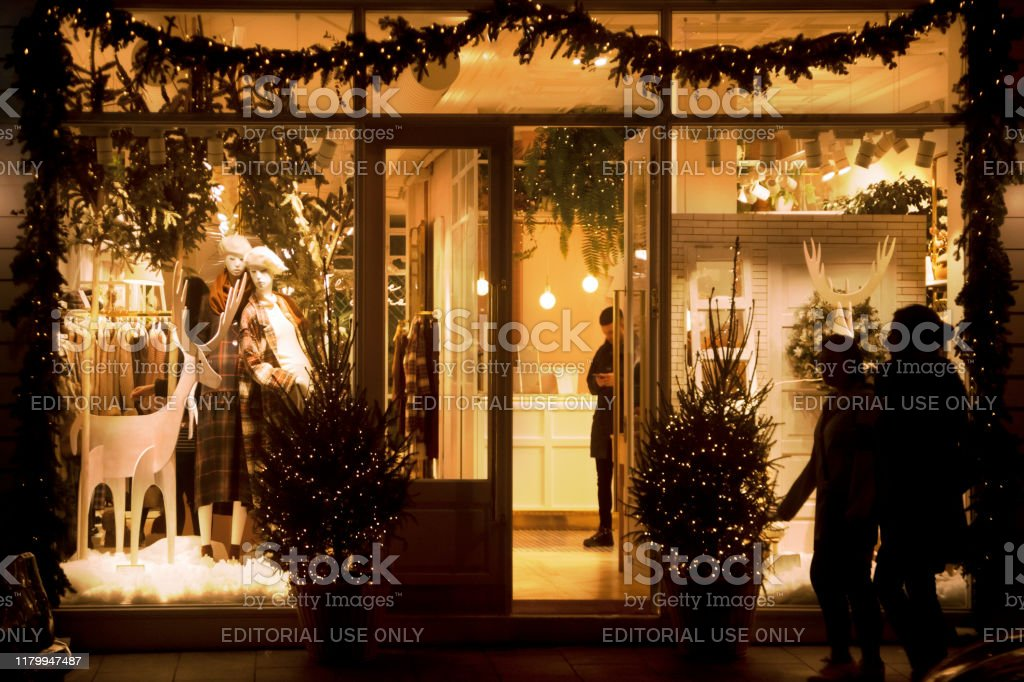 Detail Of An Illuminated Store Window With Christmas Decorations At Night Stock Photo Download Image Now Istock