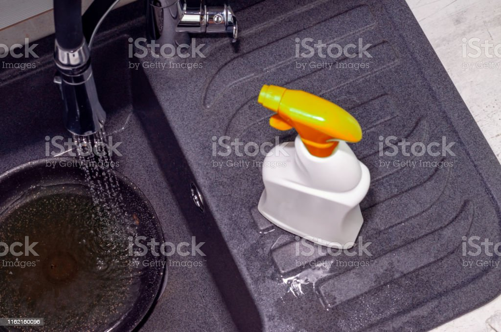 dirty dishes cleaning products sponges in a dark sink water pours stock images page everypixel