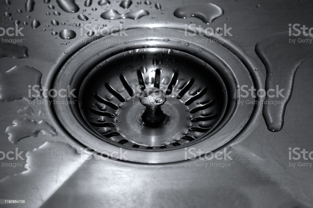 https www istockphoto com photo draining a kitchen sink with a wire rack preventing clogging of pipes gm1192654735 338938372