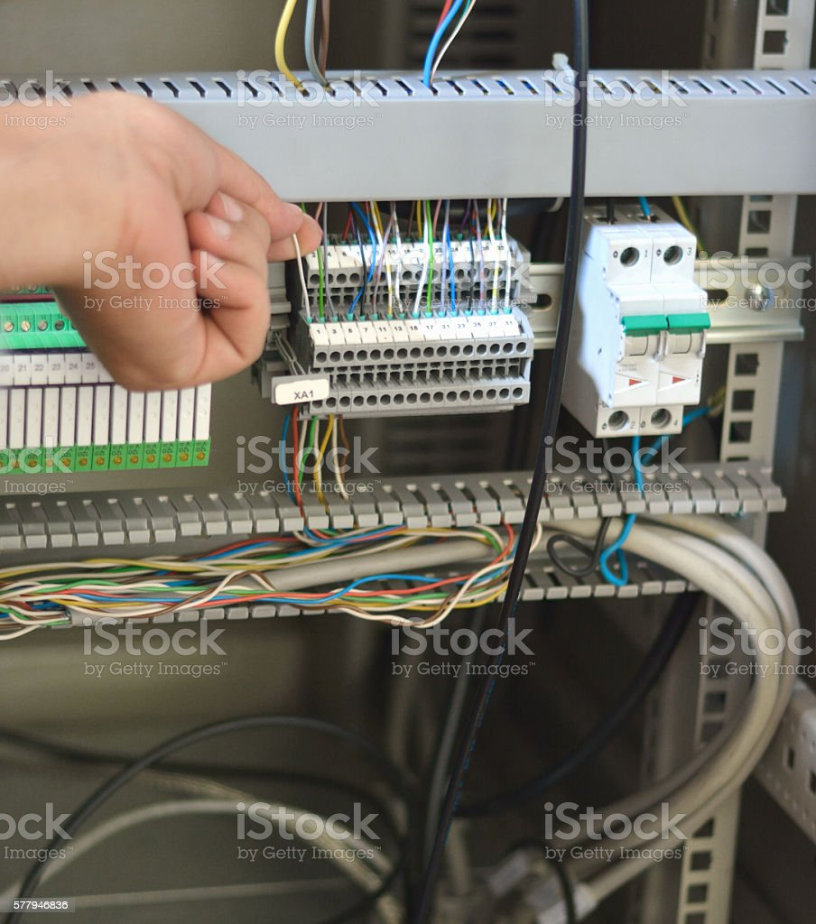 medium resolution of electrician checking wires terminal blocks electrical fuses and plc relay royalty free stock