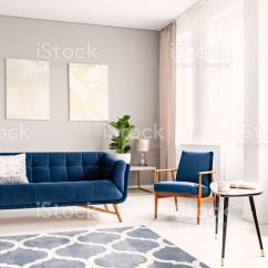 Dark Blue Couch In Living Room Rooms To Go Set Elegant Interior With A And Matching Armchair Large Windows