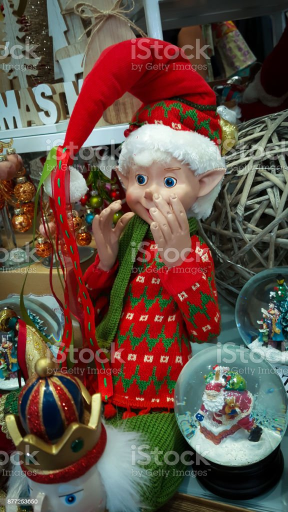 Elf Wearing A Christmas Sweater In A Display Of Christmas Ornaments Stock Photo Download Image Now Istock