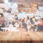 Empty Wood Table Top On Blur Light Bokeh In Dark Night Cafe Restaurant Background Stock Photo Download Image Now Istock