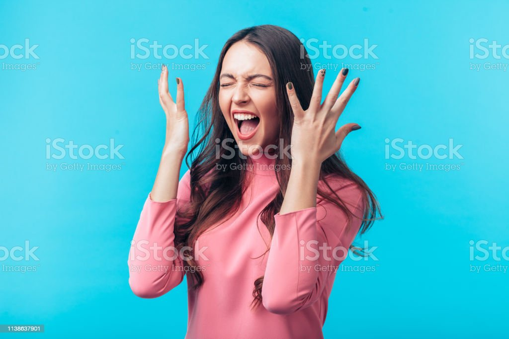 Excited Screaming Woman Portrait Isolated On Blue ...
