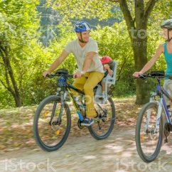 The Bike Chair Custom Barber Chairs Atlanta Royalty Free Baby Boy Is In Bicycle Seat Pictures Family Riding Park Stock Photo