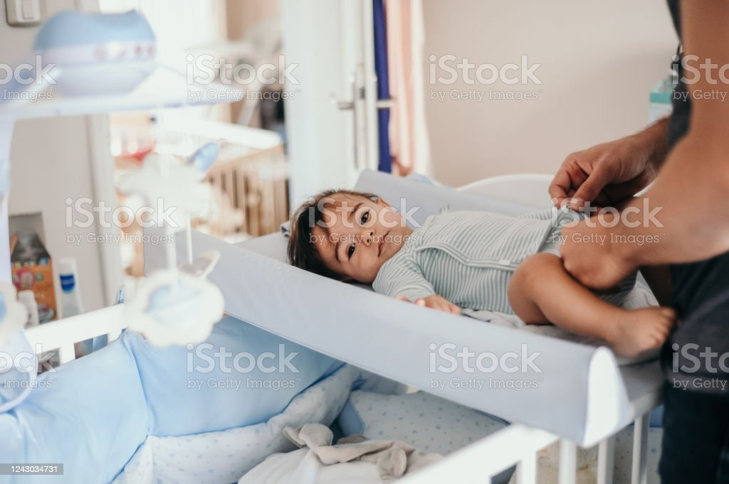 Father Taking Care Of His Baby Boy Stock Photo - Download ...