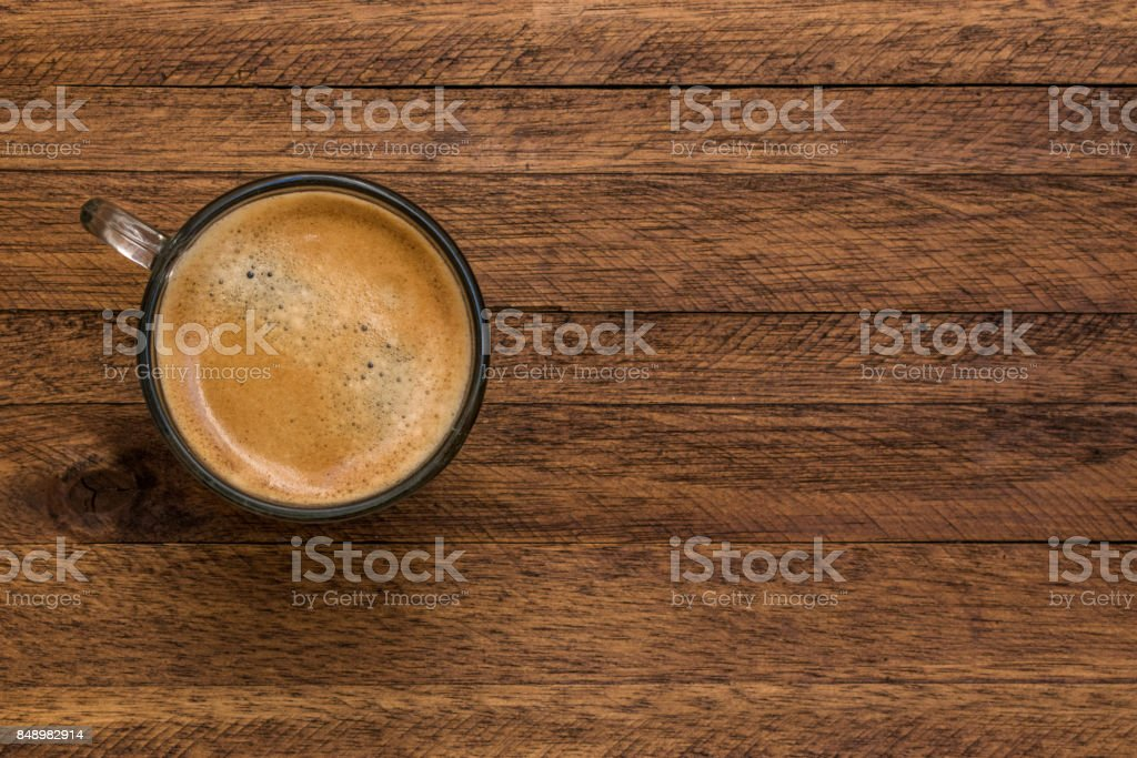 https www istockphoto com photo fresh brewed espresso coffee on an aged dark brown wood table with wood grain lines gm848982914 139295333