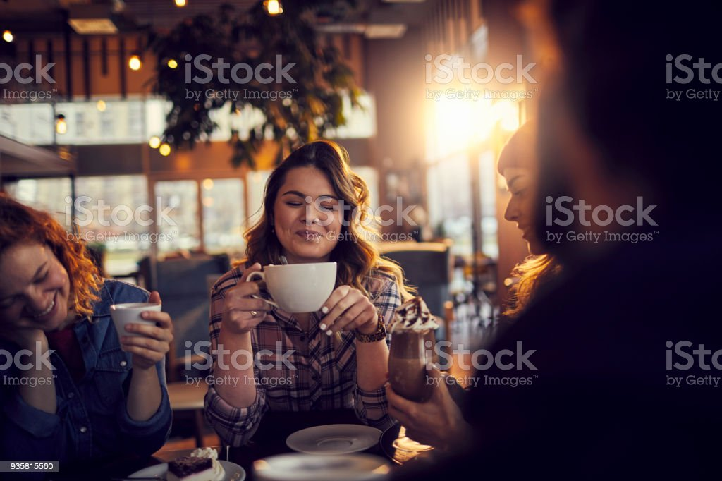 Friends At A Cafe Stock Photo - Download Image Now - iStock