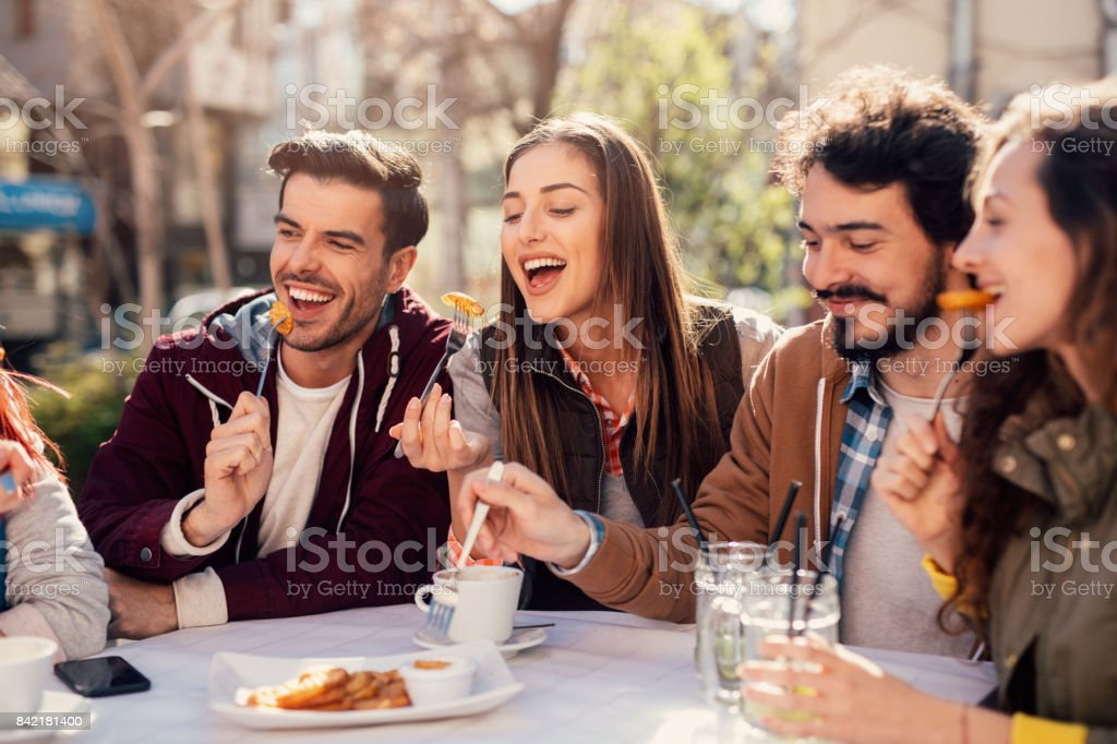 Friends Eating At A Restaurant Stock Photo - Download Image Now - iStock