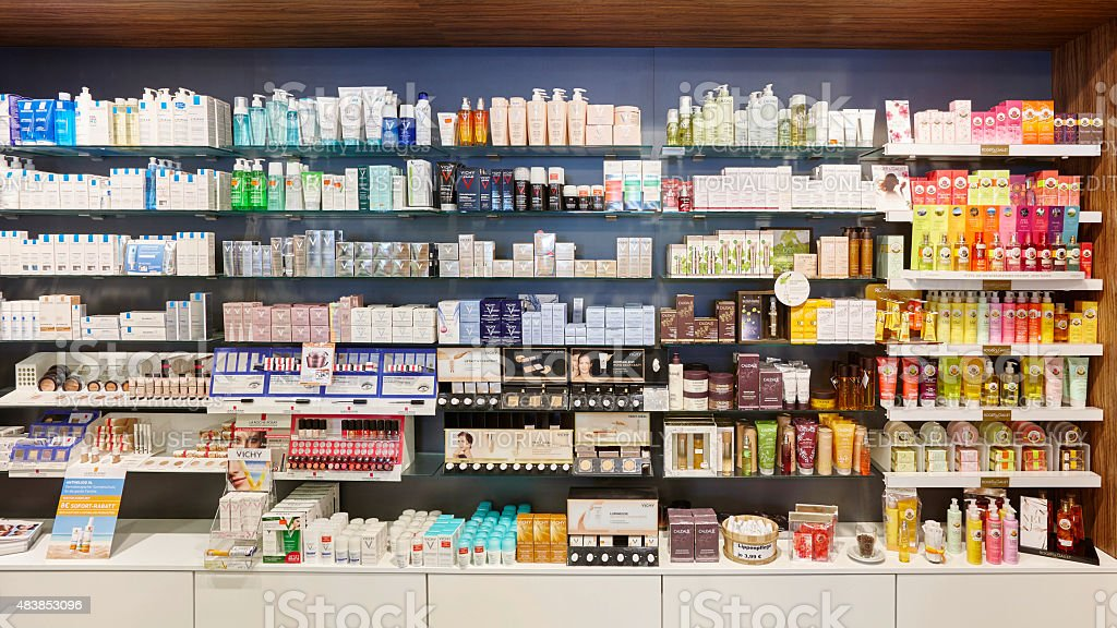 Full Cosmetics Shelves In A German Pharmacy Showing Many