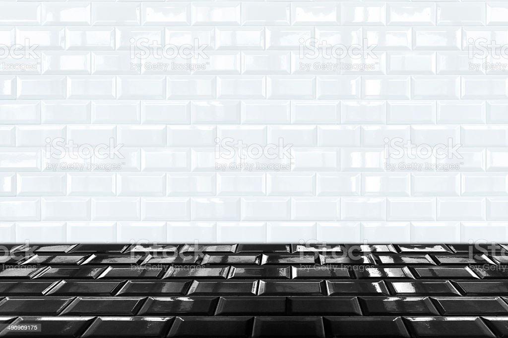 https www istockphoto com photo glossy white ceramic brick tile wall and black tile floor gm496969175 41617986