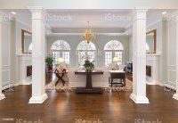 Grand Foyer And Living Room With White Pillars Halfround ...