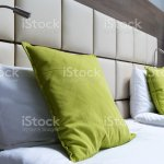 Green Pillow Reading Lamps And Leather Bed Headboard In Modern Bedroom Stock Photo Download Image Now Istock