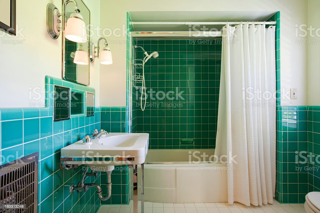 https www istockphoto com photo green tiled bathroom with white suite and shower curtain gm183313248 14828142