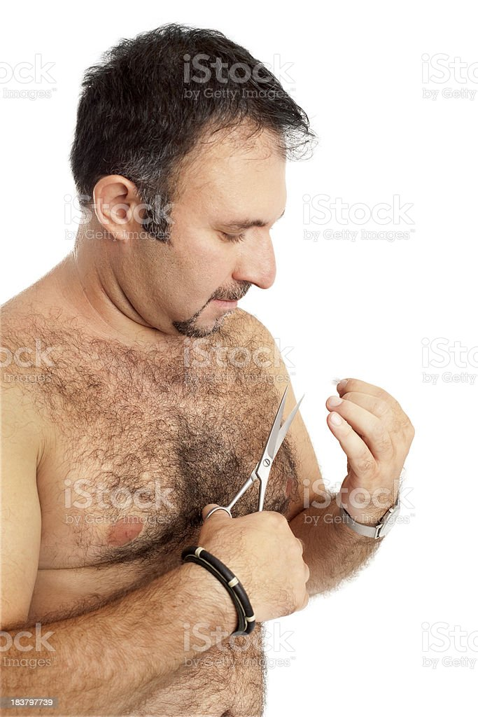 Hairy Nude Man Cutting Body Hair With Scissors stock photo
