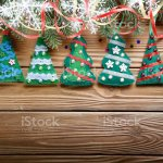 Handmade Rustic Felt Christmas Tree Decorations As Background On Wooden Table Place For Text Stock Photo Download Image Now Istock
