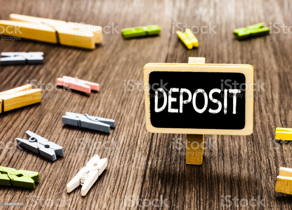 Handwriting Text Writing Deposit Concept Meaning Money Paid Into Bank Or Building Society Account Place Somewhere Blackboard Standing Several Clothespins Disorganized Messy Wooden Floor Stock Photo Download Image Now Istock