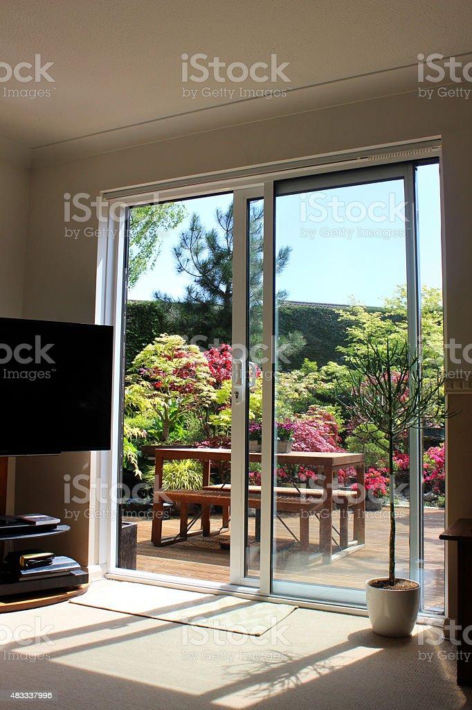 https www istockphoto com photo image of aluminium patio doors overlooking back garden with decking gm483337996 69793421