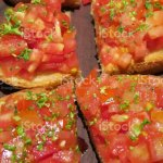 Image Of Bruschetta At Italian Restaurant With Herbs Tomato On Bread Served On Wooden Platter Healthy Snack On Dining Table Starter Appetiser Dinner Stock Photo Download Image Now Istock