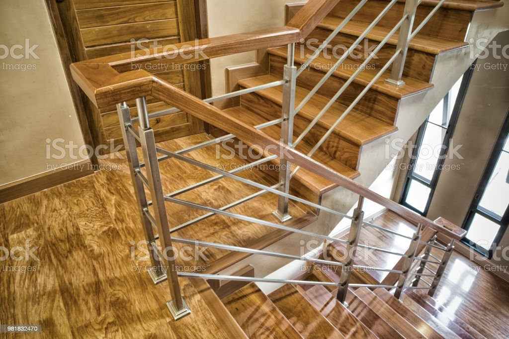 Indoor Concrete Staircase With Wood Handrail Stock Photo | Building A Handrail For Concrete Stairs | Deck Railing | Deck | Steel Handrail | Porch | Outdoor Stair