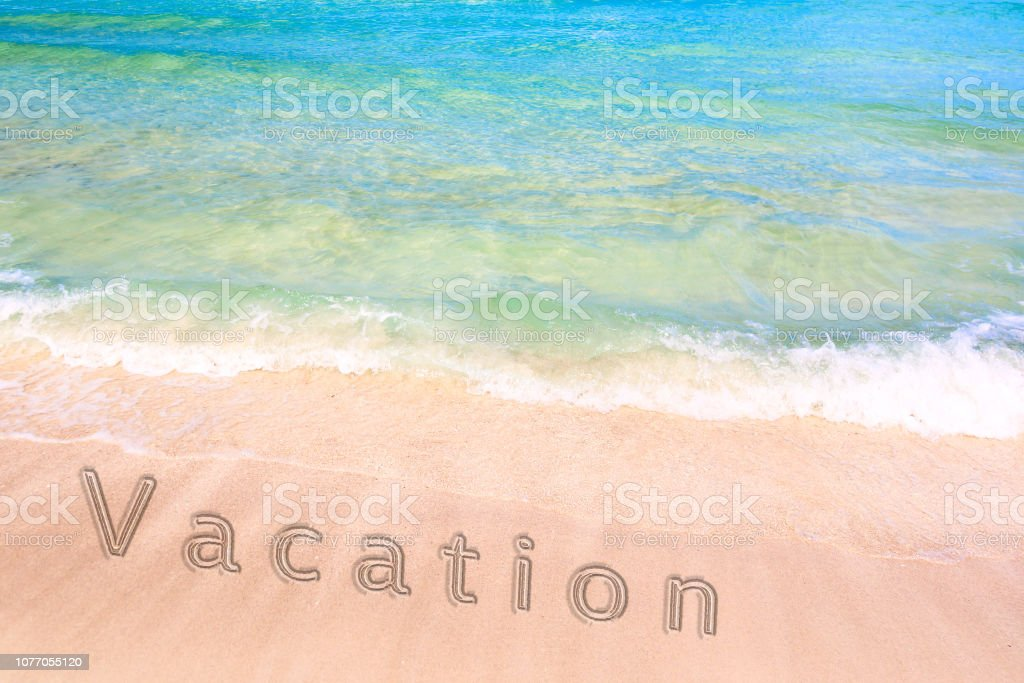Inscription Of A Vacation Word On The Sand On Beautiful Beach With A Blue Turquoise Sea Wave Concept Of A Summer Vacation And Recreation Stock Photo Download Image Now Istock