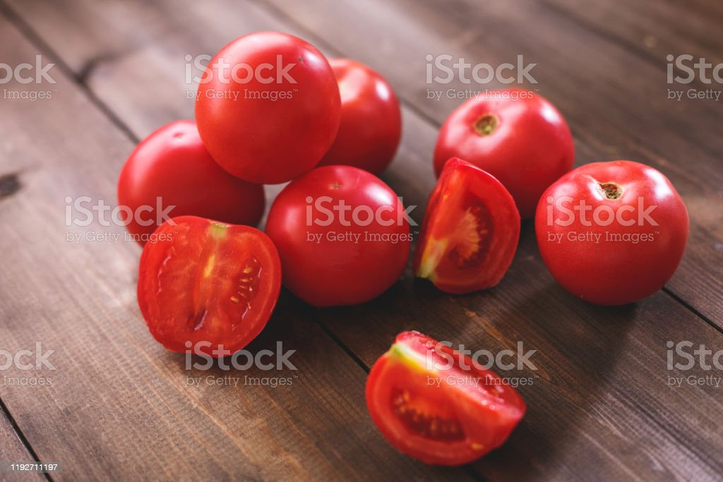 Juicy Red Tomatoes Lie On A Table Of Natural Wood Of Dark ...