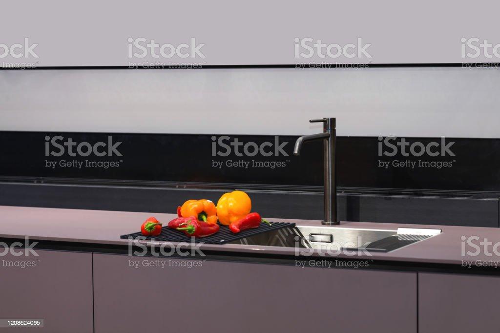 https www istockphoto com photo kitchen faucet modern grey metal plastic materials gm1208624065 349422476