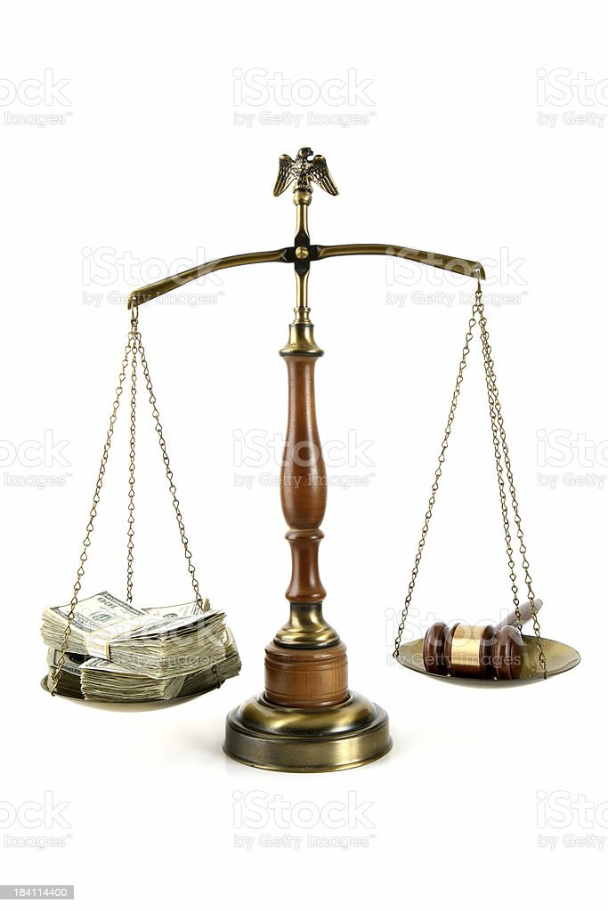 legal scales with money