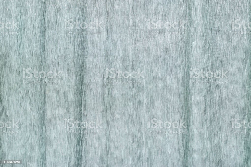 https www istockphoto com photo light blue colored silk fabric background curtain backdrop gm1183391258 332716393