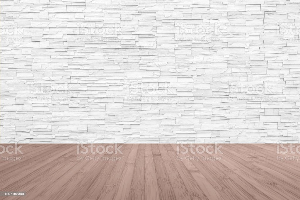 limestone rock tile wall backdrop in white grey color with wooden floor in red brown stock photo download image now istock