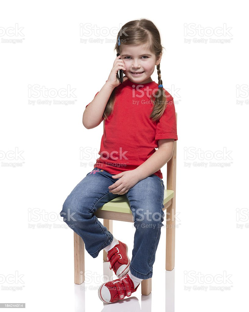 little girl chairs x rocker pro series gaming chair sitting on a and speaking by smartphone stock image