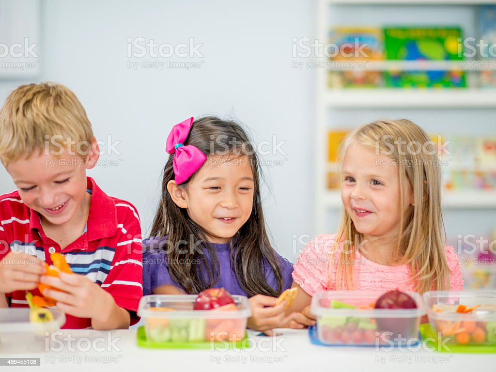 Little Kids Eating Lunch At School Stock Photo - Download Image Now - iStock