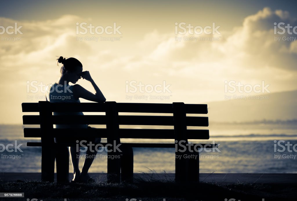 lonely woman sitting alone