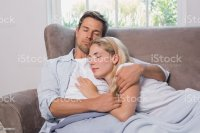 Royalty Free Cute Couple Cuddling On Couch Pictures