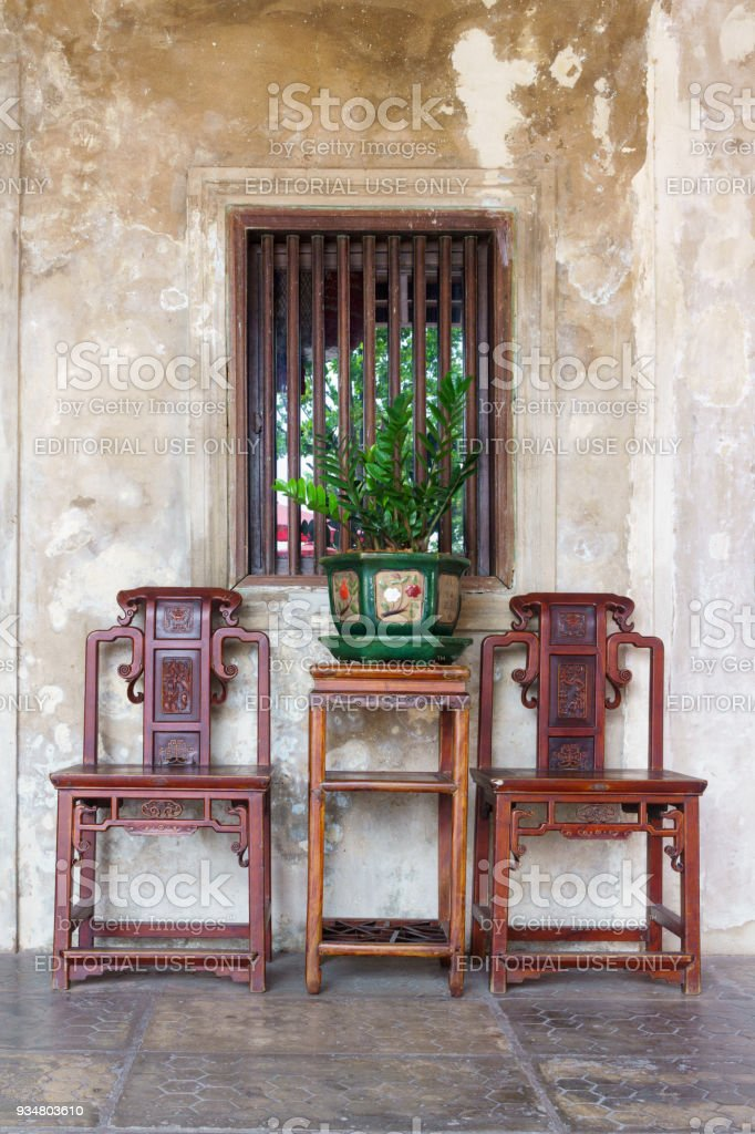chair design bangkok oversized lounge outdoor luxuary vintage retro chairs and table with green plants chinese style flower pot at lhong 1919 in thailand stock image