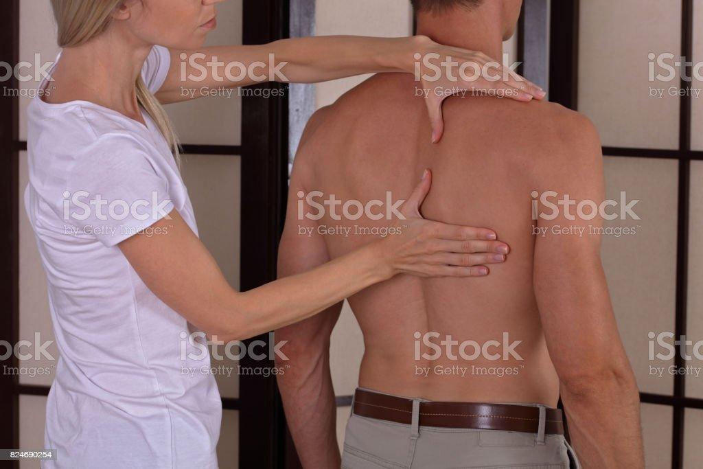 Man Having Chiropractic Back Adjustment Healing Treatment ...
