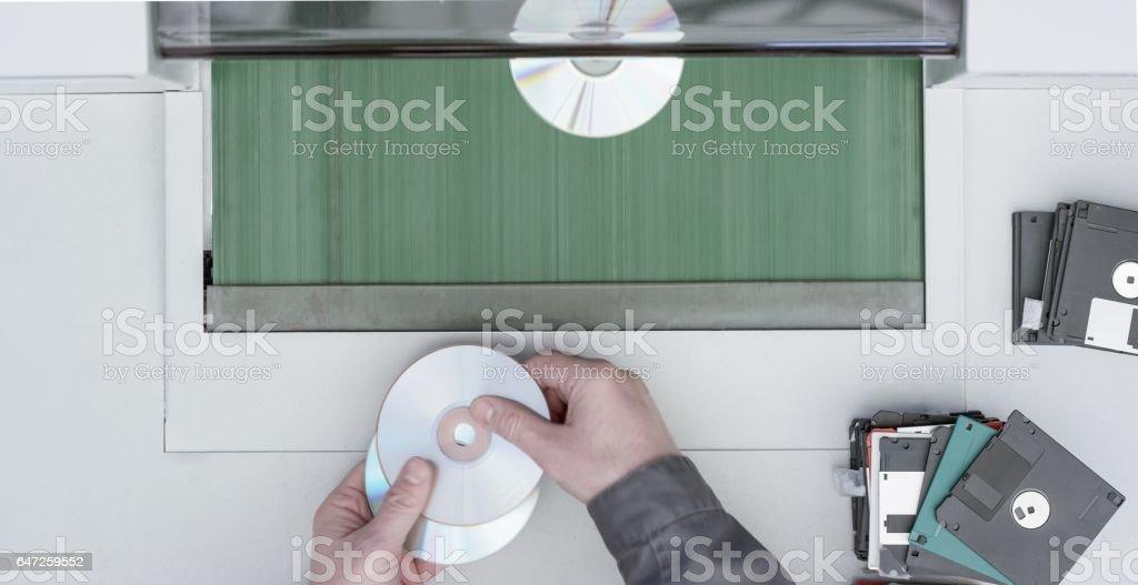 man putting cd in