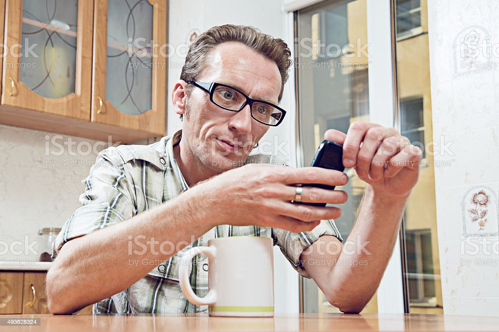 kitchen phone best cabinet manufacturers man texting message on old mobil at the stock photo royalty free