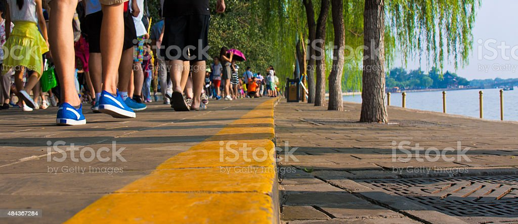 Many People Walking On The Road In The Park Stock Photo ...