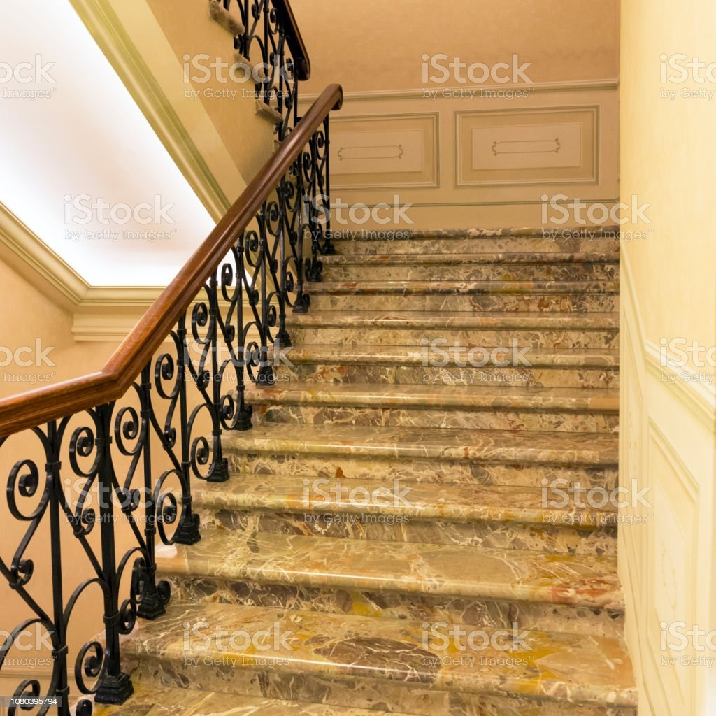 Marble Staircase With Wroughtiron Railing And Wooden Handrail   Metal Railing With Wood Handrail   Cable Railing   Wrought Iron Balusters   Stainless Steel Railing   Deck Railing   Carpeted Stairs