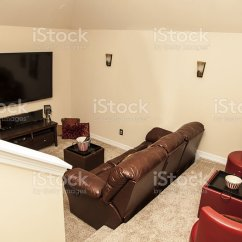 Tv Sofa 3 Seater Dimensions Media Room In Upscale New Home Large Seating Stock Photo Royalty