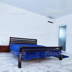 Modern Bedroom Interior With A Wooden Bed White Walls And Marble Floor Stock Photo Download Image Now Istock